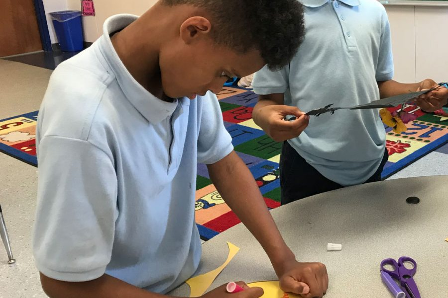 student making a card